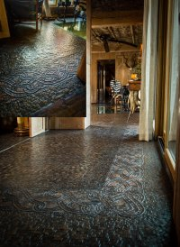"""Stunning mosaic floor"" inside the ""African Queen,"" an extravagant safari-themed home in Springfield, Missouri"