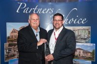 Todd Anglin, National Sales Manager, Zurn Pex, Inc. (right) accepts award from David M. Weekley, Chairman of David Weekley Homes