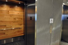 In the elevator banks, walls clad in sleek Banker Wire mesh are juxtaposed with warm-looking wood paneling, creating a contemporary space that embodies the company's identity as a state-of-the-art workplace.