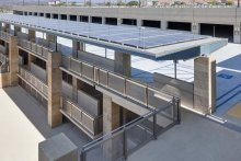 On the garage's walkways and pedestrian bridge, Banker Wire FPZ-10 woven wire mesh provides durability, fall protection and a unique look.