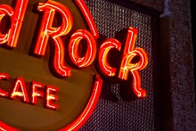 The S-15 pattern, situated behind the restaurant's logo, features a wide flat wire that is crimped in continuous waves. The undulating stainless steel wire reflects the neon of the Hard Rock Café's sign.