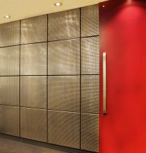 Supported by the invisible brackets in each tile's four corners, the mesh cladding brings texture and visual depth to the space.