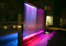 The RGB-lit wire mesh waterfall highlights the textures and sounds throughout this central space.