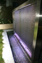 The woven wire mesh provides a unique surface for the water to cascade.