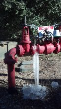 Backflow preventer in Sky Meadows now equipped with new freeze protection device, shown here properly venting freezing water from the system, thus protecting it from damage.