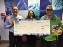 Zurn associates deliver a check to a representative of the Marine Toys for Tots organization (Zurn associates left to right): Ed Stettler and Tammi Keyes